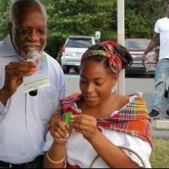Dominica's Ambassador Hubert John Charles participating in raffle drawing