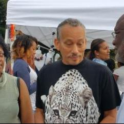 Dominica's Ambassador Hubert John Charles chatting with members of the crowd